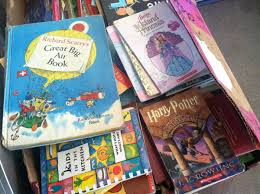 thousands of kids books collected for city buses