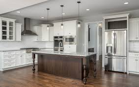 oversized pendant lighting. Beautiful, Open Kitchen With A Stainless Range Hood, Pendant Lighting, White Cabinets And Oversized Island Contrasting Dark Wood Cabinets. Lighting