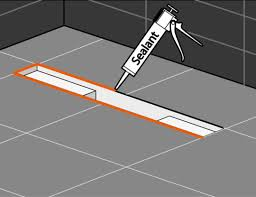 apply an elastic sealant between tiles and shower drain