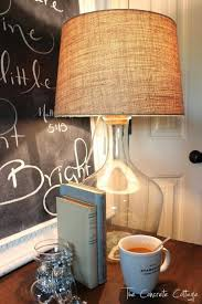 this diy pottery barn that use clift glass bottle lamp base looks striking for oversized table