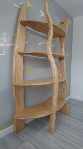 dual use furniture. The Beautiful Grain And Colours Of Ash Wood Stand Out In This Naturally Flowing Dual Sided Shelving Unit. Use Furniture