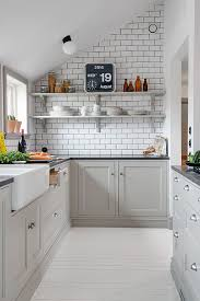 gray cabinets white subway tile with dark grout open shelves source stylish small black kitchen designs source