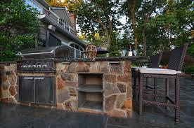 outdoor kitchen with stone veneer