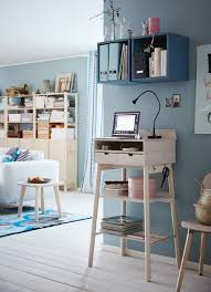 home office shelves. a corner in the livingroom with standing desk where you can read your e home office shelves