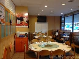 upon entering we discovered a modestly decorated restaurant with a small interior booths along the windows and large round tables in the center of the