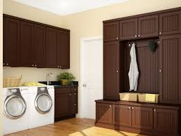 cabinets in laundry room. brown laundry room design cabinets in n