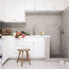 From laundry to a dog bath these cement tiles and fresh blooms make any  chore better .