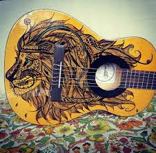beautiful hand painted classical guitar with zentangled lion design if you wish to purchase this