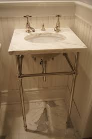 undermount sink with a marble top on console legs