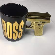 Find gun shaped coffee mug now! Pistol Grip Gun Handle Ceramic Coffee Mug Boss Black Gold Sportscards Com