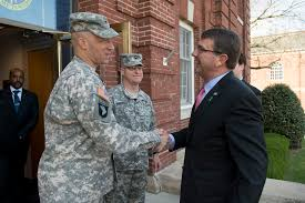 u s department of defense photo essay defense secretary ash carter right exchanges greetings army col johnny davis