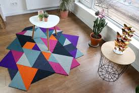 this low budget diy project is about using new but leftover carpet tiles and transform them into a modern looking colourful rug for your home