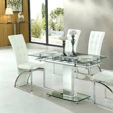 extending dining table in clear glass and chrome frame extendable tables ikea canada