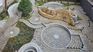 Small Picture Swirling brick circles form back garden for South London Gallery