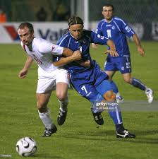 Vedin Music of Bosnia and Herzegovina vies for the ball with Ivan... News  Photo - Getty Images