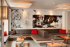 meininger cafe  on cafe wall artwork with win a stay in a berlin hotel hostelbookers