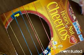 DIY Musical Instruments: Cereal Box Guitar | Music instruments kids, Diy  musical instruments, Homemade instruments