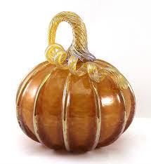 small topaz pumpkin with gold stripes by ken hanson and ingrid hanson art glass sculpture