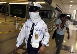 Security Guard Wears A Cloth Over His Face After A Small