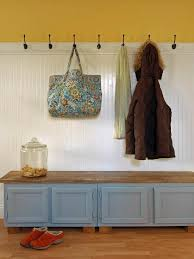 traditional mudroom with white beadboard and a functional storage bench
