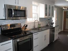 maple kitchen cabinets with black appliances. Wooden Backless Bar Stool Kitchens With Black Appliances And Countertops Sleek Grey Backsplash Tile Butcher Block Countertop Knife Holder Maple Kitchen Cabinets