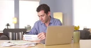 man handling personal finances at desk 4k stock footage clip