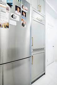 washer and dryer in a kitchen cabinet gif playing