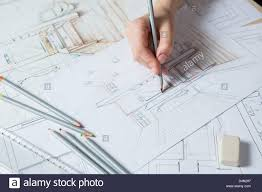 interior design hand drawings. Interior Designer Works On A Hand Drawing Sketch Using Color Pencils, Rule And Rubber Design Drawings E