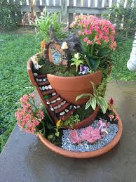 everyone loves the tiny plantings and accessories in a fairy garden the latest trend involves building that miniature landscape in a broken pot