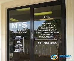 glass office signs for attorneys in palm beach county fl door