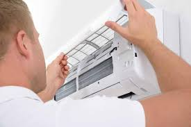 air conditioning options. man adjusting air conditioning system options