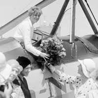 amelia earhart s last flight amelia earhart receives a bouquet of flowers upon arriving in denver