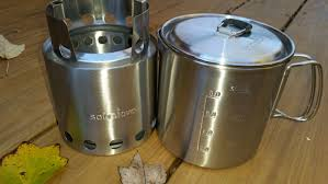 stove lite. the design.. both of these products are made from stainless steel. have durable nylon type stuff sacks with drawstrings for storage. stove lite u