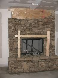 fireplace in progress kits cast stone surround natural fieldstone doors living room faux brick wall fireplace