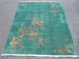 art deco chinese rug hand knotted wool china ca 1930 mint green with numerous splashy colors full plush pile in great condition the approximate size
