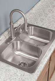 designed with thoughtful details the tuscany double bowl kitchen sink kit includes a x x double bowl kitchen sink a single handle pulldown faucet with