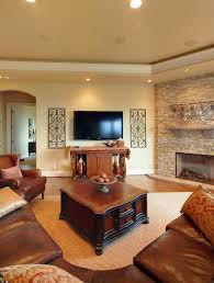 living room with stone fireplace. this southwestern style living room has a corner fireplace with an enclosed hearth and rustic stone