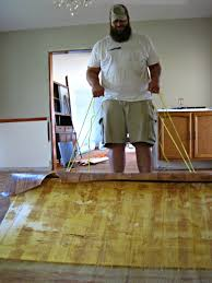 we quickly realized that it was best to carefully cut the flooring into smaller sections to pull it up because it was glued down with what i can only hope