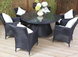 patio outdoor dining set with brown wicker chairs and large soho sets swivel
