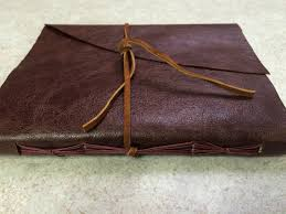 wrapped leather journal this was a specialty writing journal done in glaze leather very thick luxurious hand sewn with a colored binders