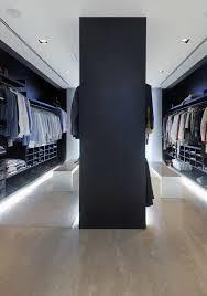 bachelor pad walk in closet with floor lighting