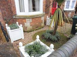 the small formal front garden