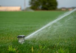 ✓ Grass automatic sprinkler water showering Images, Pictures and Free Stock  Photos