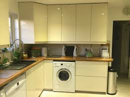 ikea high gloss yellow white kitchen cupboard doors and some units