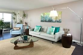 beige living room area rug green wall art with and silver arc down decorative pillows artwork 7