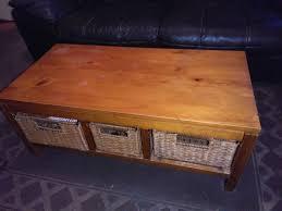 next oak coffee table with wicker baskets