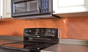 iron chef stainless steel and copper backsplashes
