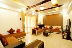 dark color shades looking more attractive with bination of white living room designs india