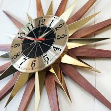 starburst wall clock vintage starburst sunburst atomic era brass wood wall clock very clean spoke brass starburst wall clock
