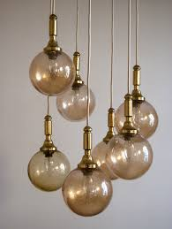 70s hanging lamp with brass golden glass